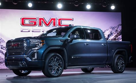gmc sierra    truck pushes  silverado  carbon fiber bed transforming