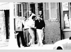 Supposedly that is Vinny Asaro shaking John Gotti's hand