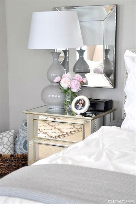 neutral master bedroom white  gray bedding mirrors