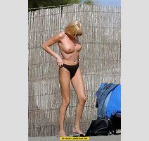 Stefania Orlando Sunbathing Topless On The Beach