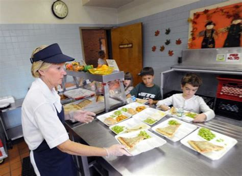 cafeteria worker fired  giving food  hungry children