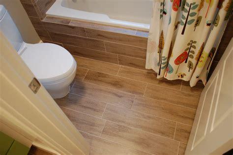wood textured tiles on bathroom floor and tub renew green wood bathroom tile floor thraam com