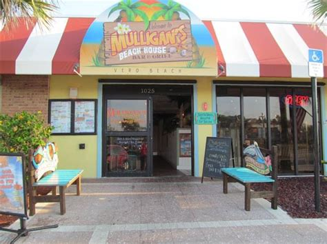 mulligans beach house bar grill   expand