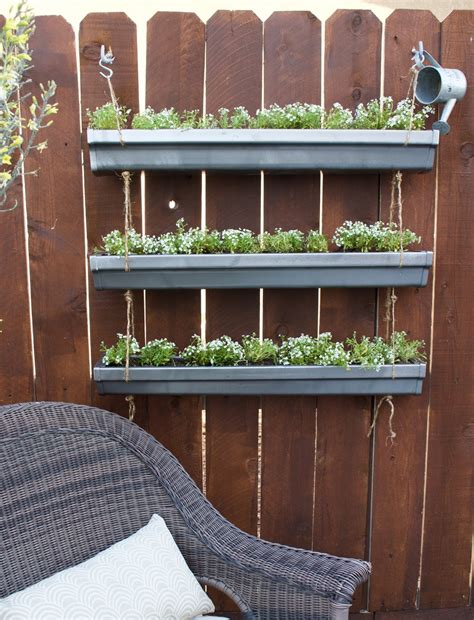 hanging gutter planter a house and a