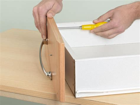 tools needed to install kitchen cabinets repairing cabinet drawer handles how tos diy