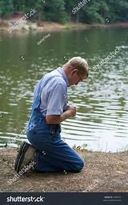 Man On His Knees Praying Beside Stock Photo 4060231 ...