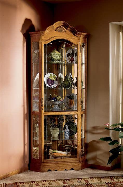 locking curio cabinet howard miller wilshire golden oak corner curio cabinet 680 207 3835