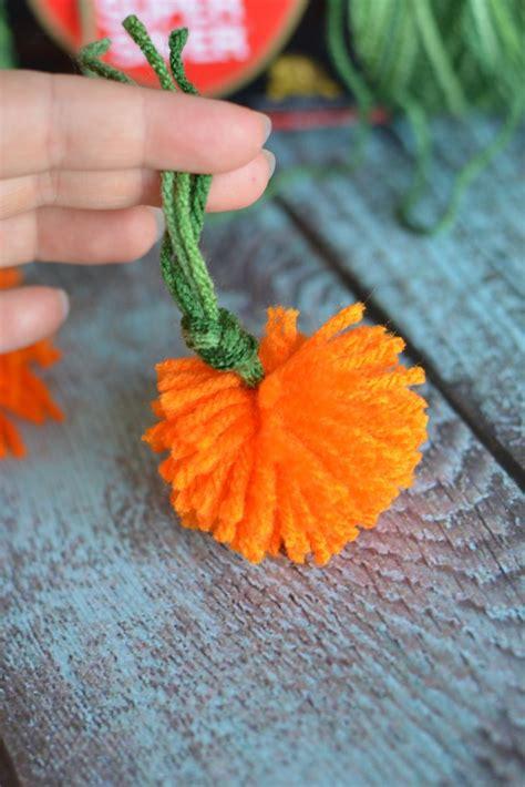 easy diy yarn pumpkins  sew pumpkin garland