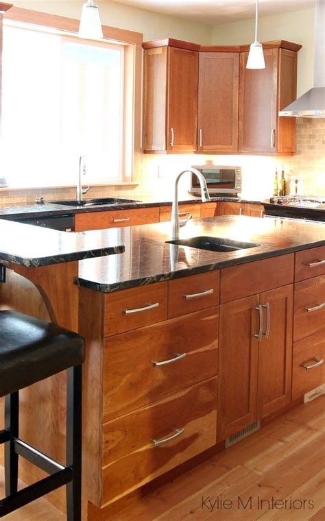 Natural fir flooring, cherry cabinets, black granite on
