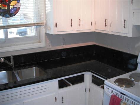 uba tuba granite goes great with white cabinets
