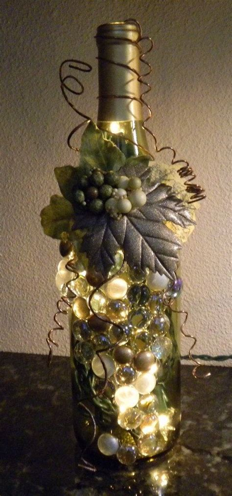 Decorative Wine Bottles With Lights by Decorative Embellished Wine Bottle Light With Leaves