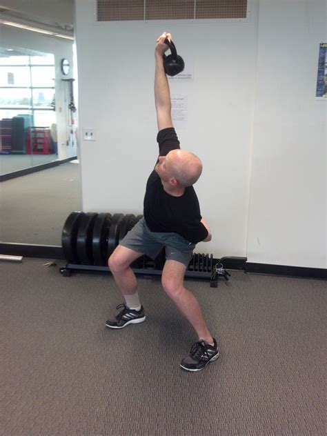 kettlebell overhead squat swing into exercise press fitness health transition keeping while side