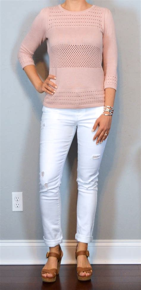 Outfit post pink sweater white distressed jeans brown wedges