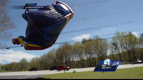 bounce house blows away child injured when bounce house at church festival blew