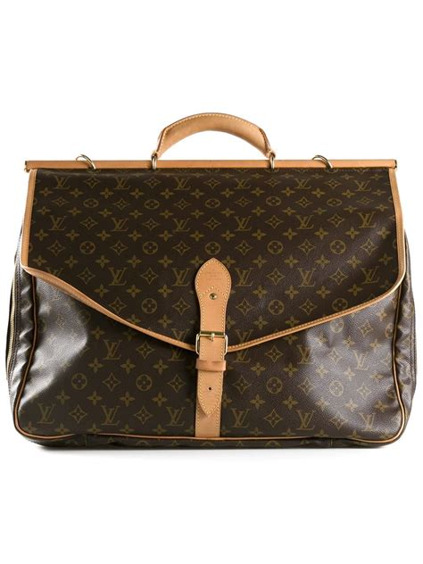 lyst louis vuitton sac chasse travel bag  brown
