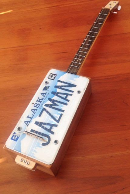 cigar box guitar license plate resophonic   recycled cedar fencing  custom maple