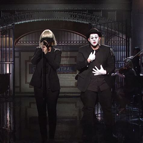 sia sings chandelier and elastic in a mime