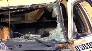 Cab hits light poles, bursts into flames; 2 hurt ...