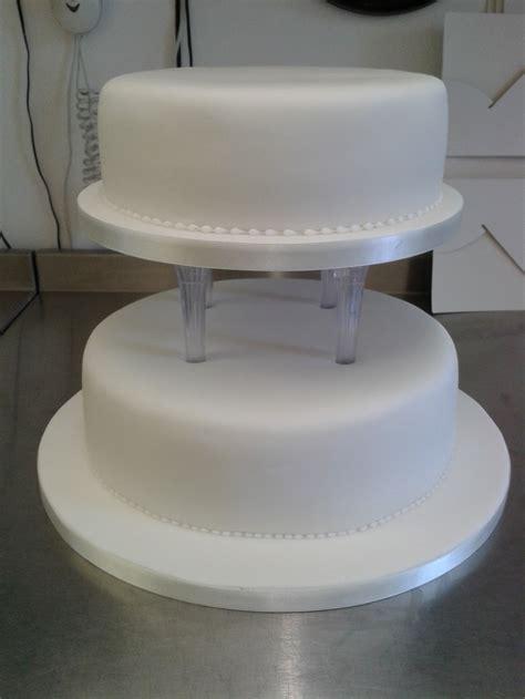 plain  tiered pillared wedding cake crumbs cake shop
