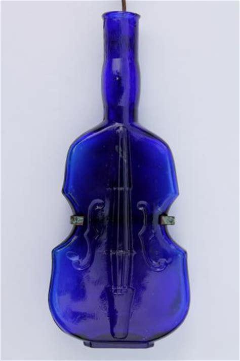 cobalt blue glass violin bottle  wire wall rack  display