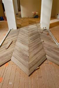 installation of the parquet floor chevron in oak gray With chevron parquet flooring