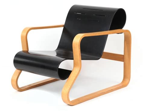 pair of paimio lounge chairs by alvar aalto modern