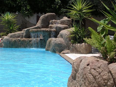 what to plant around a pool tips for landscaping near swimming pools install it direct