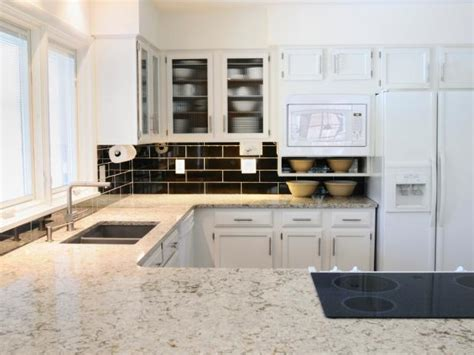 white kitchen cabinets white countertops white granite countertops hgtv 1809