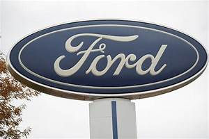 Ford Motor Company will require that workers wear face masks and have their temperatures taken ...