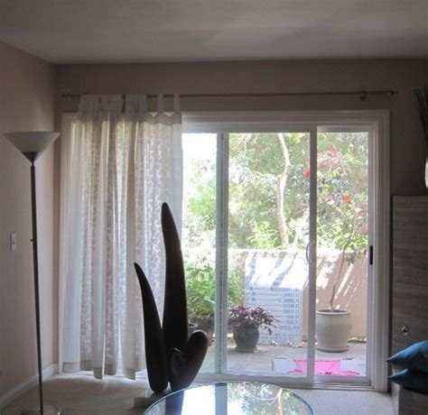 how high above window should i hang new curtains drapes