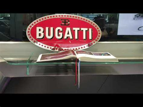 The arch over the doorway stands 4m. Bugatti show room - YouTube