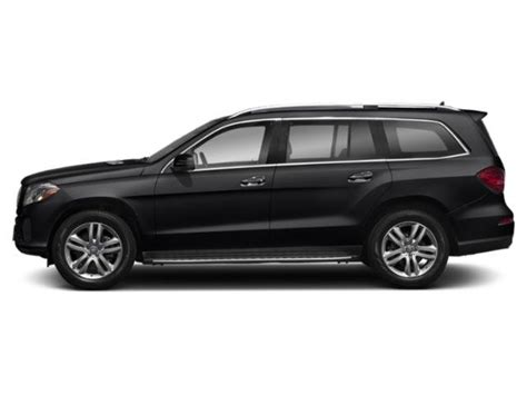 Its interior upgrades include ambient lighting, leather dashboard, special wood trim, and premium porcelain/expresso brown leather upholstery with stitched surfaces. 2019 Mercedes-Benz GLS 450 4MATIC SUV | Black 19-579