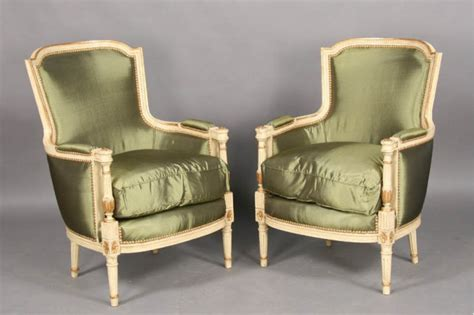pair louis xvi painted gilt bergere chairs for