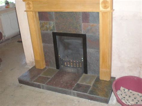 slate tiles in fireplace which adhesive
