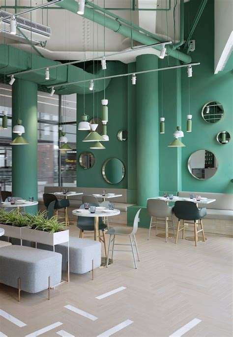 Within the shop, a retail section offers coffee beans, tea, and pins for sale. 5 -EdenEat by INDOOR DESIGN (With images) | Restaurant interior, Restaurant seating, Bar ...