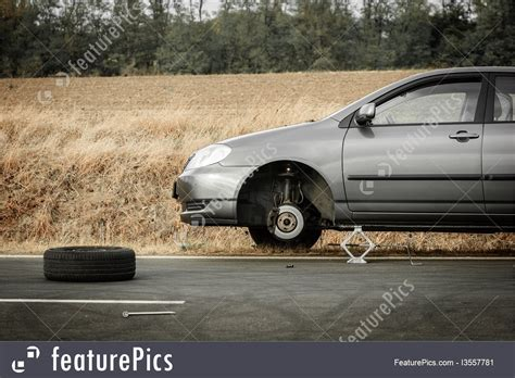 Photo Of Broken Car Without Tire On The Road