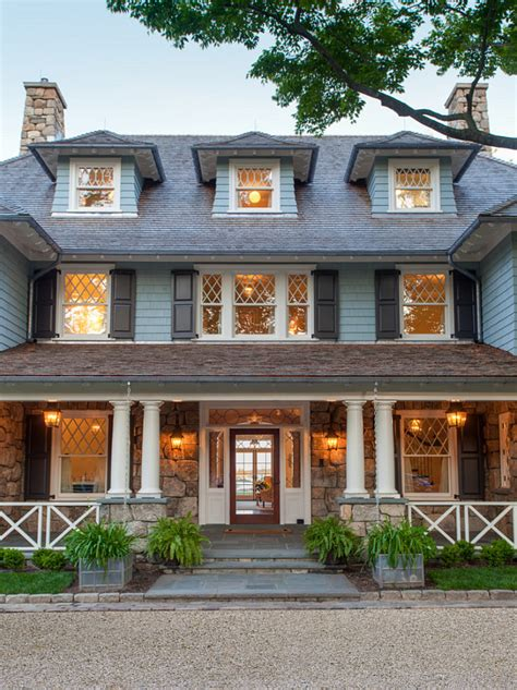 Traditional Shingle Home With Blue And White Interiors