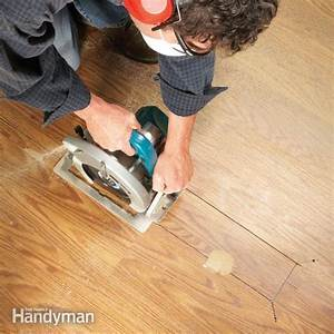 Laminate floor repair the family handyman for How to fix buckling hardwood floors