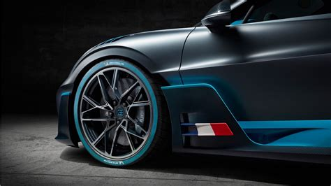 There are huge air intake at the front bugatti also took measures to create an optimized curtain of air flowing around the sides of the car, while vents behind the wheel arches reduce pressure. 2019 Bugatti Divo 4K 9 Wallpaper | HD Car Wallpapers | ID #11116