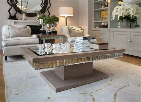 You can always put a tray on one to prevent spilling and use that. Mirrored Coffee Table Tray | Roy Home Design