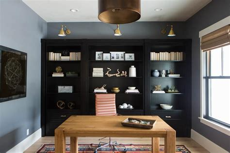 Office With Black Built In Shelves  Transitional Den