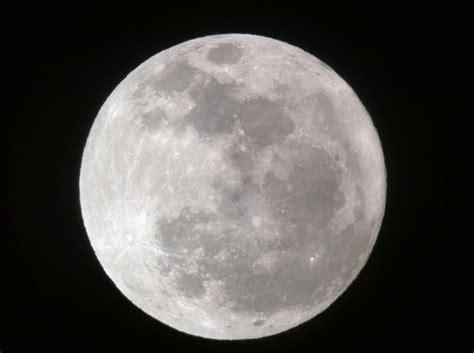 full moon dominates planet filled night sky tonight