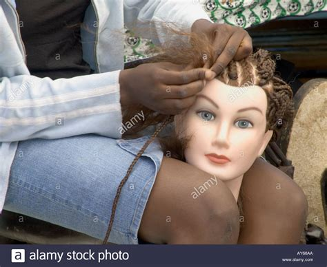 Girl Practicing Braiding Hair On A Mannequins Head Stock