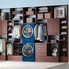 stackable washer dryer in master closet master bath