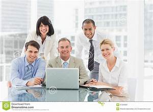 Happy Business People Gathered Around Laptop Looking At ...
