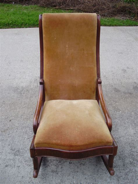 antique walnut upholstered rocking chair with