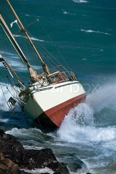 Crash Boat Weather by Yacht Crash On The Rocks In Stirmy Weather Stock Photo