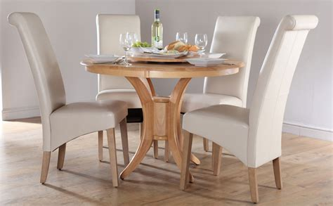 In great condition, comes with 6 chairs (slight stains on some of the chair's fabric; Round Dining Table Set for 4 - HomesFeed