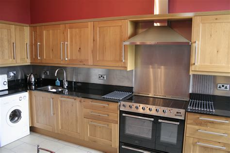 kitchen with stainless steel backsplash 301 moved permanently