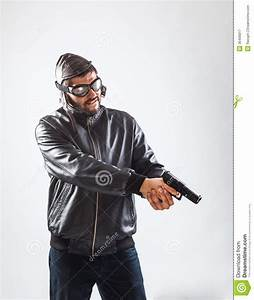 Young Man Holding A Gun With Both Hands Royalty Free Stock ...